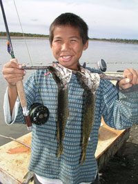Successfully young angler with pike - Kalskag Science Camp