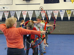 Line of archers drawing their bows