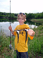 Youth with fishing pole and his catch