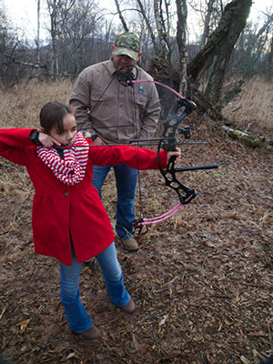 Hunter mentors young bowhunter