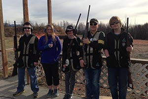 Youth holding shotguns at Rabbit Creek range