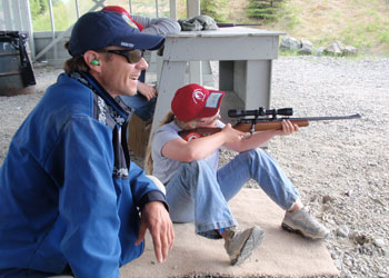 Student taking aim under instructor supervision