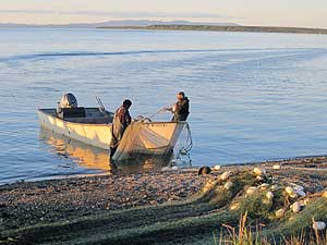 Kotzebue fishermen with net and boat on the beach