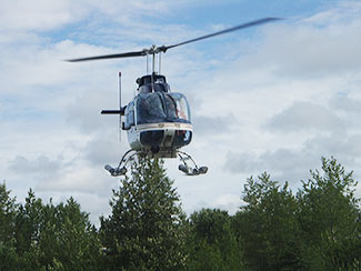a helicopter is flown over the creek to assess the salmon population from the sky