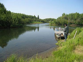Rod and reel fishing location on a Kuskokwim tributary accessible by boat.