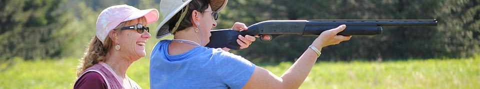 Alaskans Afield staff trains a participant with a shotgun