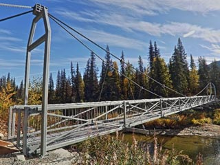 Hunter access bridge in wilderness