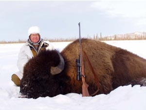 Photo of a successful bison hunter