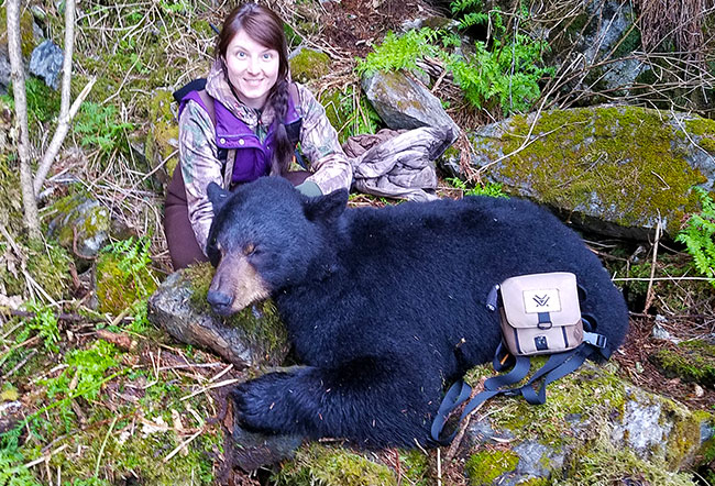 Successful hunter with black bear