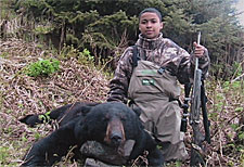 Photo of a successful Black Bear hunter.