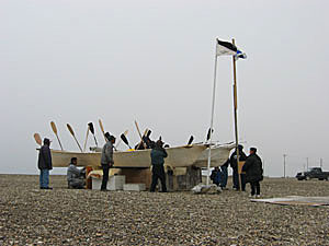 Umiaqs at Point Hope during the celebration of a successful bowhead whaling season