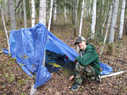 Youth setting up a tent with a tarp