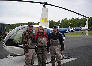 Photo of staff with a helicopter